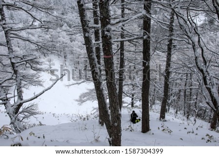Asama, JAPAN-15 january 2017: Hiking in snow on Asama 2000 volcano  during winter in Japan.  #1587304399