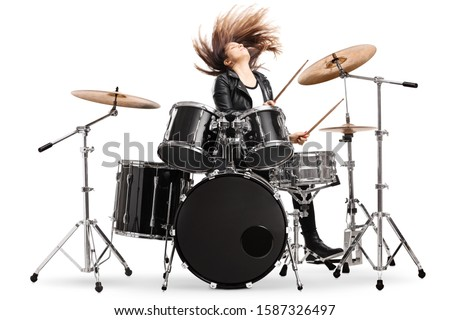 Energetic female drummer throwing her hair and playing drums isolated on white background #1587326497