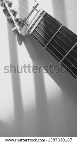 white electric guitar closeup . white background