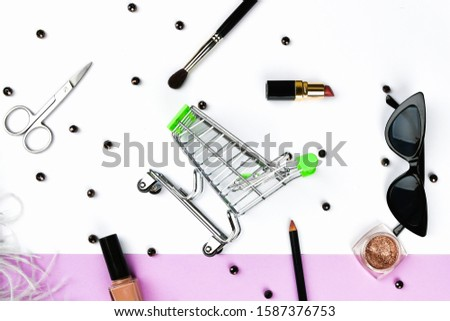Basket and womens accessories. Womens accessories, on a pink background pastel. Beauty and fashion concept. Top view, flat minimalism. #1587376753