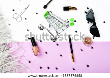 Basket and womens accessories. Womens accessories, on a pink background pastel. Beauty and fashion concept. Top view, flat minimalism. #1587376858