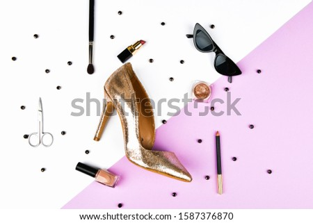 Womens shoes and accessories. Basket and womens accessories. Womens accessories, on a pink background pastel. Beauty and fashion concept. Top view, flat minimalism. flat lay #1587376870