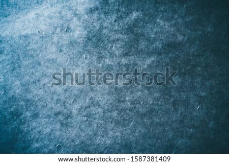 Dark blue textured paper background. #1587381409