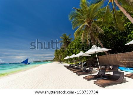Sun umbrellas and beach chairs on tropical coastline, Philippines, Boracay  #158739734