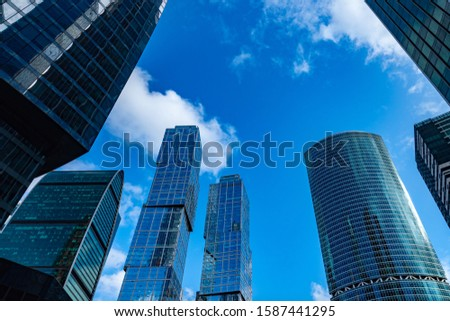 Business center of the city. Corporate center. Skyscrapers against the sky. The tops of glass skyscrapers. Glass walls of office buildings. Down town. Commercial real estate. Moscow City. Russia. #1587441295