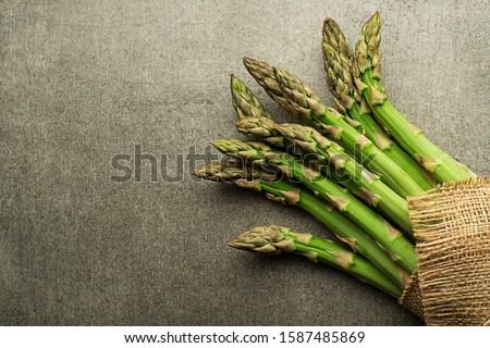 Asparagus. Fresh Asparagus. Green Asparagus. Bunches of green asparagus, top view- Image #1587485869