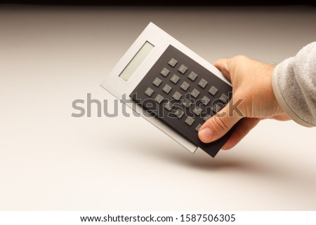 Financial and mathematical calculations helped by a calculator to pay the bank or to make daily purchases in times of crisis. Buy and pay for commodities #1587506305
