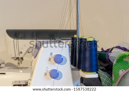 Overlock sewing machine with four spools of thread #1587538222