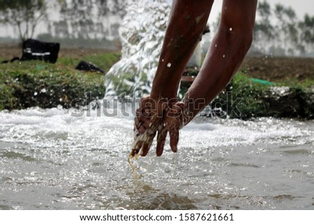 Unrecognizable person washing hand & feet in fresh water. #1587621661