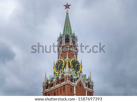 Famous Spasskaya Tower of Kremlin in the clouds, Kremlin chimes and spire with ruby star - symbols of Russia. Moscow, Russia    #1587697393