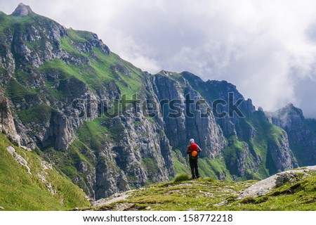 Hiker in the mountains enjoying the view #158772218