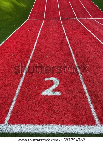 The Number two lane on a track and field track #1587754762