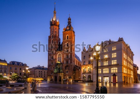 Market Square at sunrise in old city center at Krakow at morning time, main square, famous cathedral at sunrise in Krakow, Poland. #1587795550