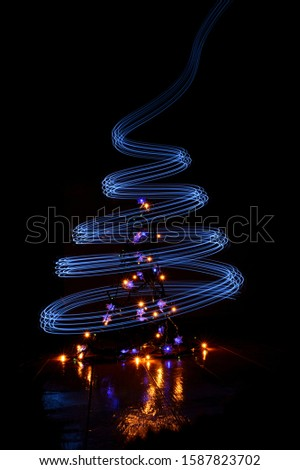 Christmas tree abstract image created with light painting photography technique, Christmas/New year card