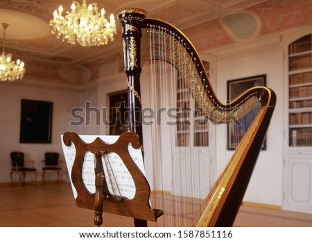 Music stand and harp, Monastery Andechs, Bavaria, Germany Royalty-Free Stock Photo #1587851116