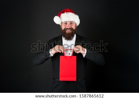 Buy new year gifts. Shopping for presents. Discount for club members. Delivering your purchase. Everything you need to fight winter chill. Shopping with pleasure. Bearded man hold shopping bag. #1587865612