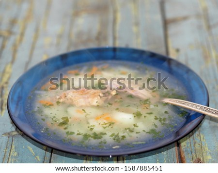 Potato soup with meat on a blue rustic rustic table background #1587885451