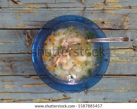 Potato soup with meat on a blue rustic rustic table background #1587885457