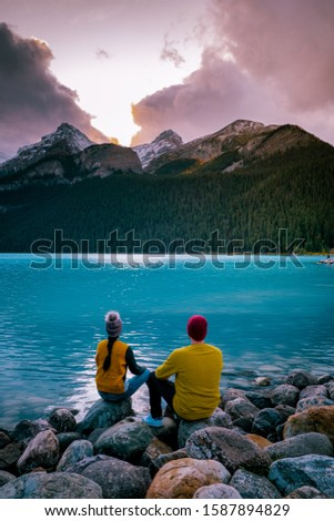 couple on vacation in the Canadian Rockies, Beautiful autumn views of iconic Lake Louise in Banff National Park in the Rocky Mountains of Alberta Canada #1587894829