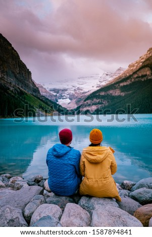 couple on vacation in the Canadian Rockies, Beautiful autumn views of iconic Lake Louise in Banff National Park in the Rocky Mountains of Alberta Canada #1587894841
