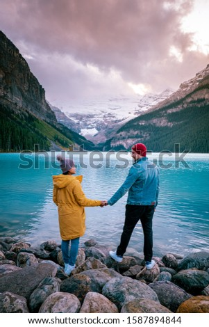 couple on vacation in the Canadian Rockies, Beautiful autumn views of iconic Lake Louise in Banff National Park in the Rocky Mountains of Alberta Canada #1587894844