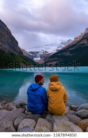 couple on vacation in the Canadian Rockies, Beautiful autumn views of iconic Lake Louise in Banff National Park in the Rocky Mountains of Alberta Canada #1587894850