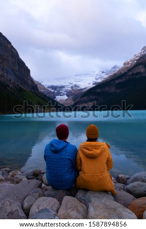 couple on vacation in the Canadian Rockies, Beautiful autumn views of iconic Lake Louise in Banff National Park in the Rocky Mountains of Alberta Canada #1587894856