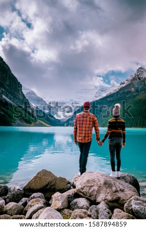couple on vacation in the Canadian Rockies, Beautiful autumn views of iconic Lake Louise in Banff National Park in the Rocky Mountains of Alberta Canada #1587894859