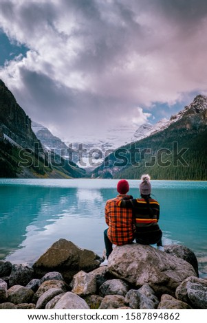 couple on vacation in the Canadian Rockies, Beautiful autumn views of iconic Lake Louise in Banff National Park in the Rocky Mountains of Alberta Canada #1587894862