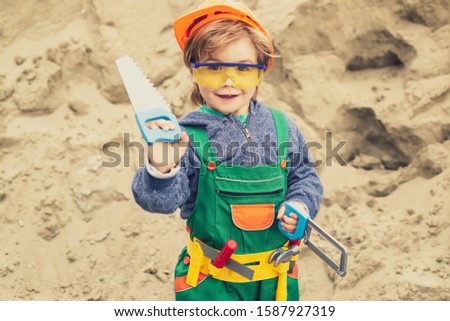 Business, building, industry, technology, builder concept. Young builder in hard hat. Close up engineers working. Children hobby portrait. #1587927319