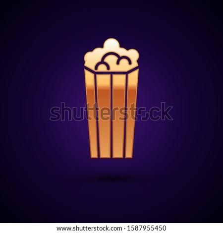 Gold Popcorn in cardboard box icon isolated on dark blue background. Popcorn bucket box.   #1587955450