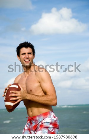 A young man with a ball on the beach #1587980698