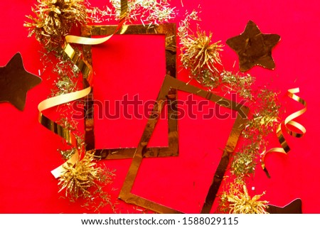 Merry Christmas and Happy New Year. Flat lay photo with golden mockup photo frames and Christmas decorations on bright red background. Xmas greeting card, banner. Copy space for the text #1588029115