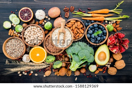 Ingredients for the healthy foods selection. The concept of healthy food set up on wooden background. #1588129369