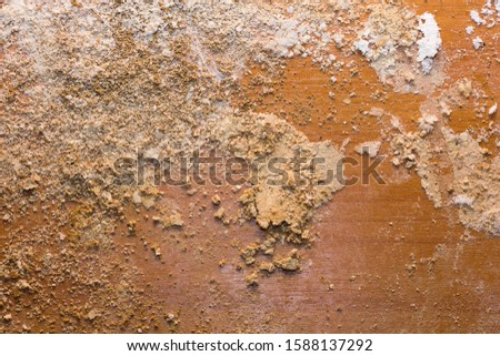 The background picture taken on the floor of the room has the powder of termite nest as an abstract image.