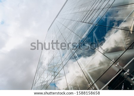 Reflection of the sky on a skyscraper. View of skyscrapers from below