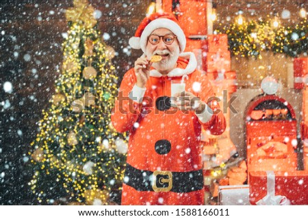 Santa Claus with beard and mustache. Santa Claus in hat. Christmas for Santa Claus. Santa Claus enjoys cookies and milk left out for him on Christmas eve #1588166011