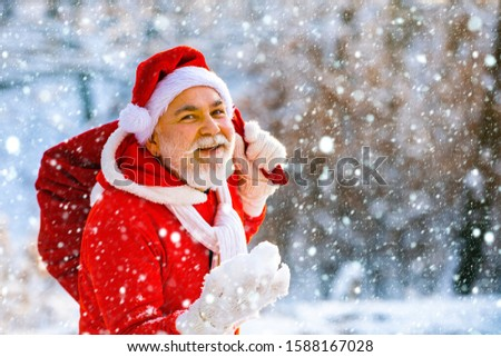 New year concept. Happy new year. Wish you merry Christmas. Merry Christmas. Santa in red suit walking along the road to Christmas #1588167028