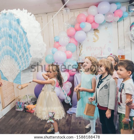 Perm/Russia - June, 28, 2019: Little girl is going to broke the pinata. Children birthday party. #1588188478