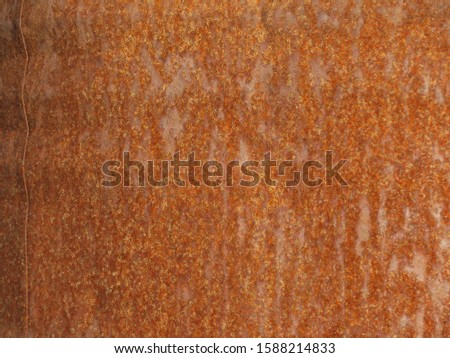 Rusty metal background. Rusty iron texture. Red grunge background. Fragment of a rusty iron barrel.                           #1588214833