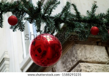 A christmas bll in a traditional Christmas decoration. #1588293235