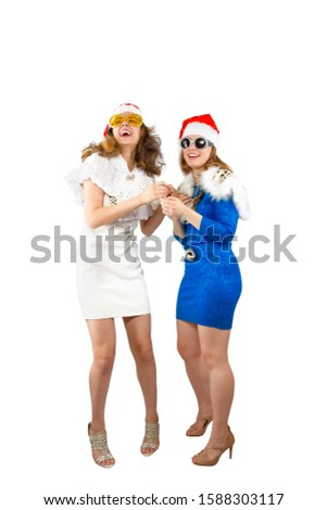 Happy laughing women in Santa hats having fun isolated on white backdrop Happy New Year 2020 celebration holiday concept. Mock up copy space.