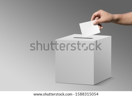 concept vote election Election of members of parliament, president, chief, executive. a ballot paper in hand isolated with clipping path on background #1588315054