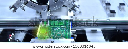 Technological process of soldering and assembly chip components on pcb board. Automated soldering machine inside at industrial,banner side #1588316845
