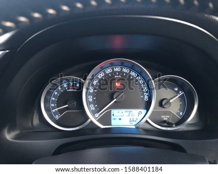 Car dashboard showing odometer, speedometer, tachometer and fuel guage #1588401184