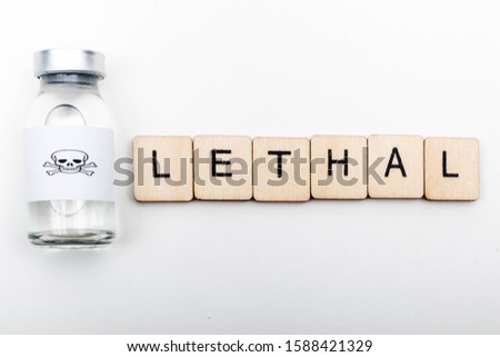 A glass medical vial with a skull and crossbones on a white background with a sign reading Lethal #1588421329