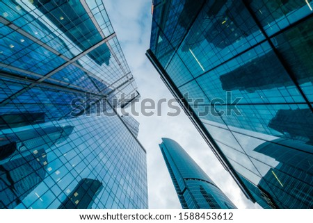 Skyscrapers in downtown area, bottom view, blue tones Royalty-Free Stock Photo #1588453612