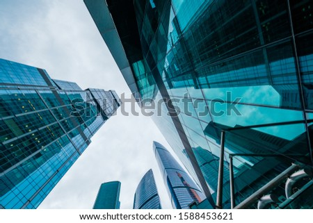 Skyscrapers in downtown area, bottom view, blue tones #1588453621