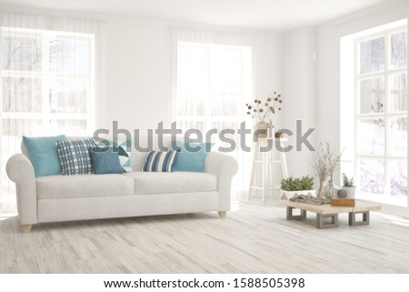 Stylish room in white color with sofa and winter landscape in window. Scandinavian interior design. 3D illustration #1588505398