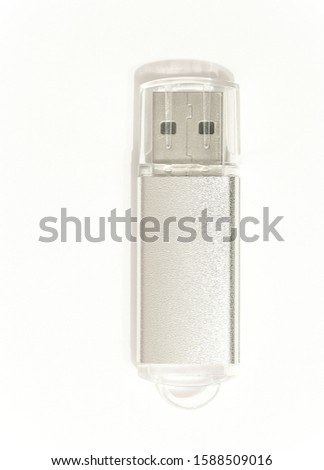Digital flash drive with Universal Serial Bus plug light gray on a bright white background in an upright position #1588509016